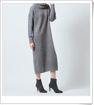 体のラインを拾わない袖ケーブル編みニットワンピース